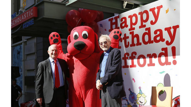 Scholastic President/CEO Dick Robinson, Clifford, and Norman Bridwell