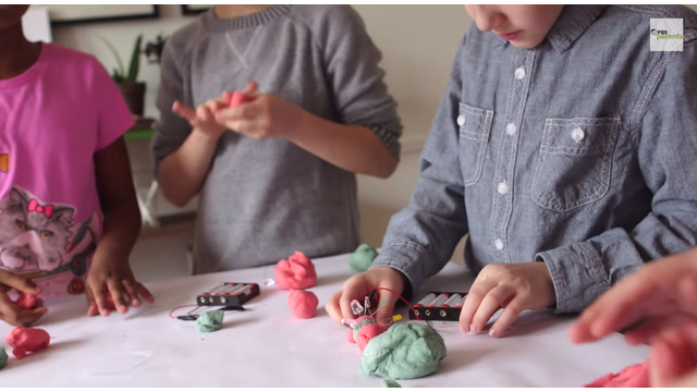 kids playing with electric play dough