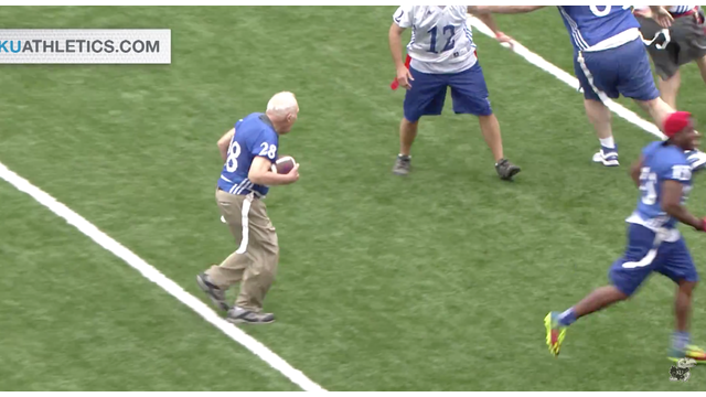 Photo of Bryan Sperry running the football