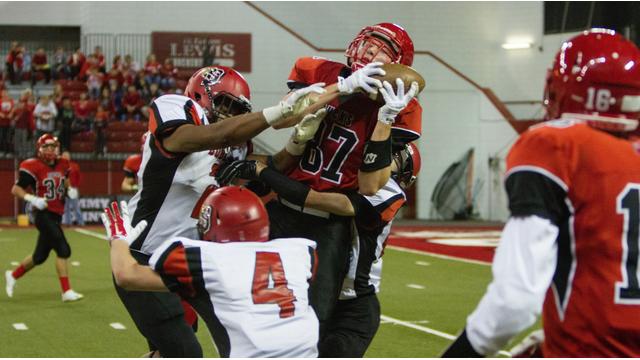 photo of high school football player catching a pass