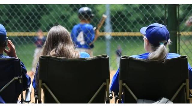 Parents watching baseball