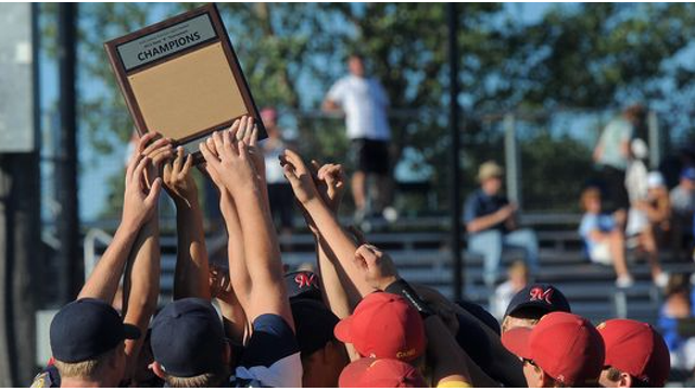 baseball team holding up champion plaque