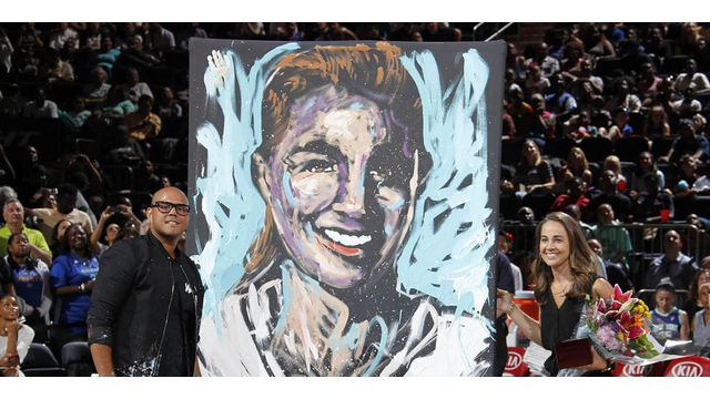 Becky Hammon and a painting