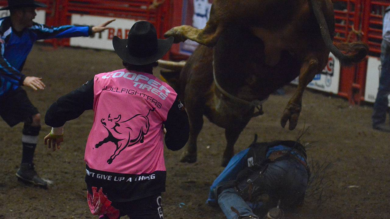 Bullfighters Cooper Waln and Colin Lamont rush in to help a rider