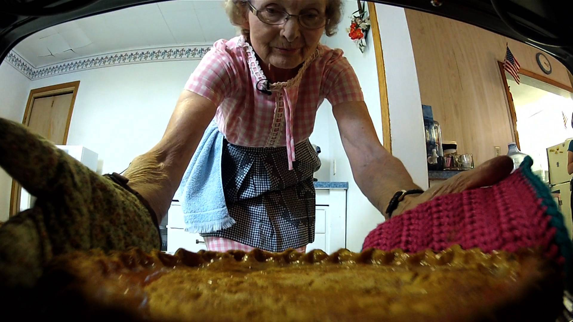 Verna Knapp takes a fresh baked pie out of the oven
