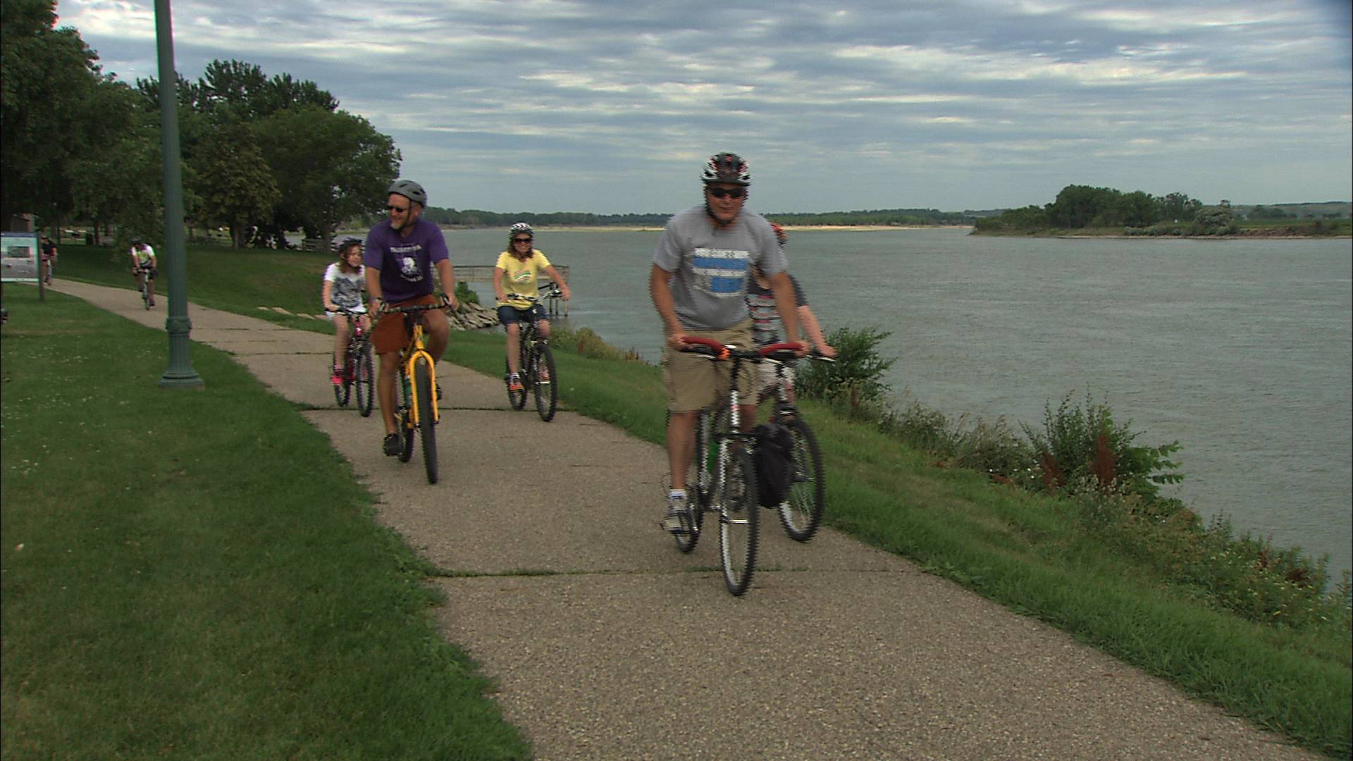 A Yankton family rides their bikes along the banks of the Missouri