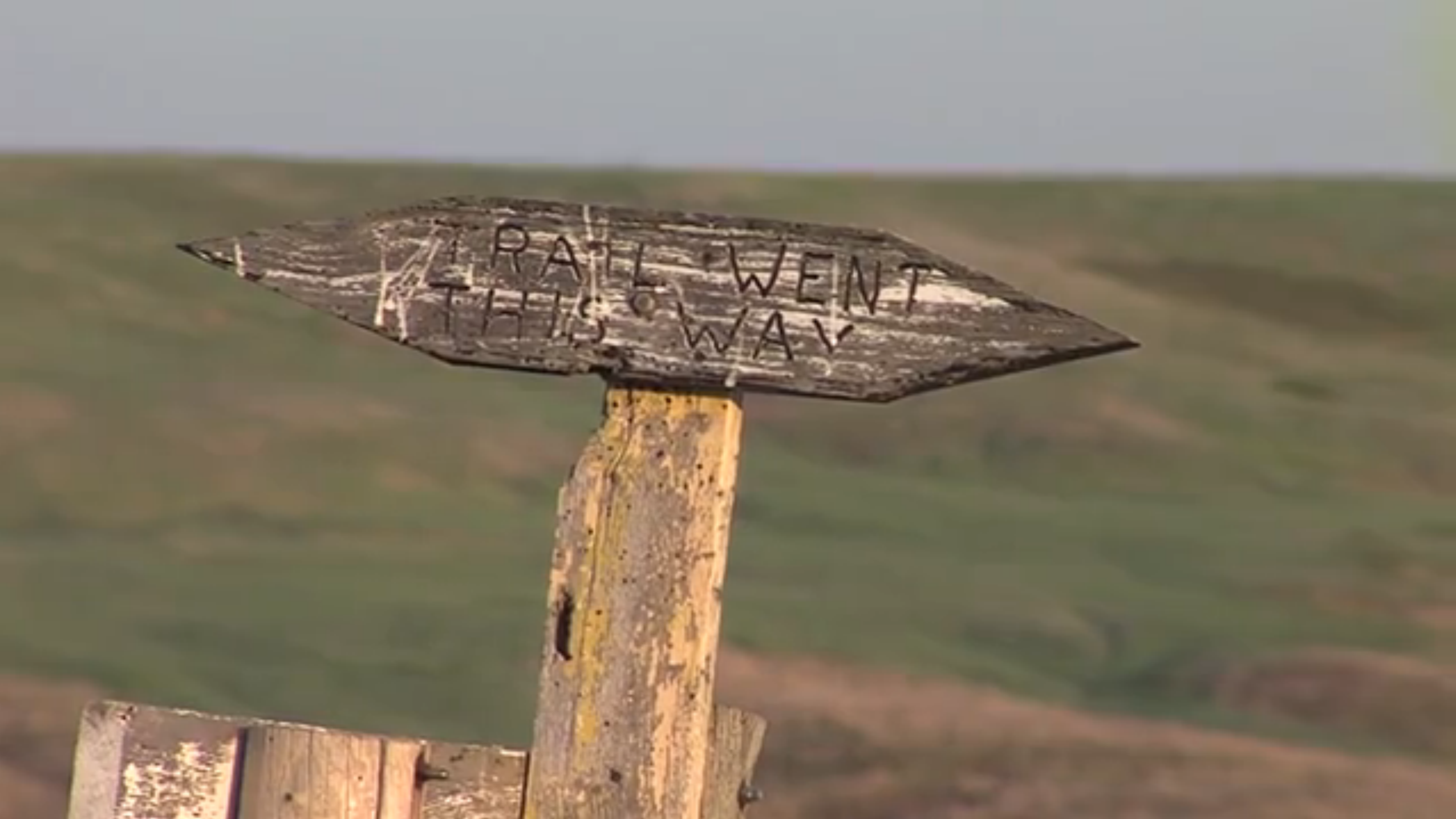 Carving of trail sign