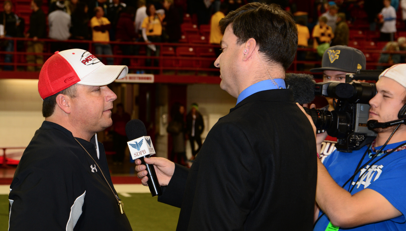 photo of head coach Aaron Beavers being interviewed