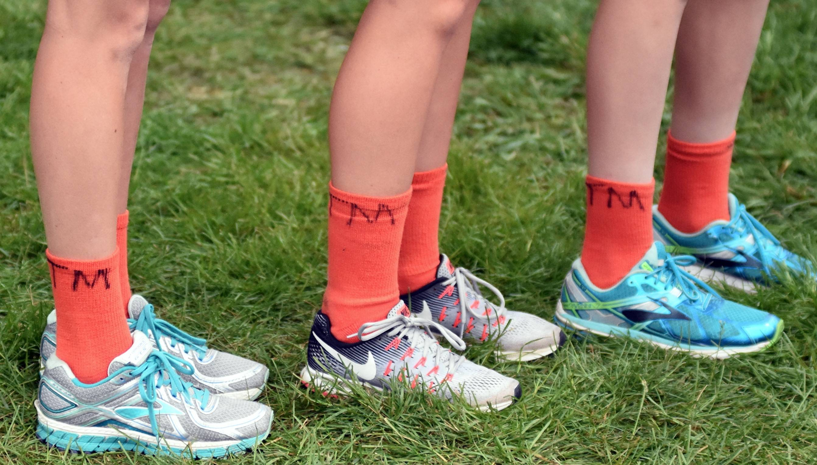 Track runners socks with TM written on them