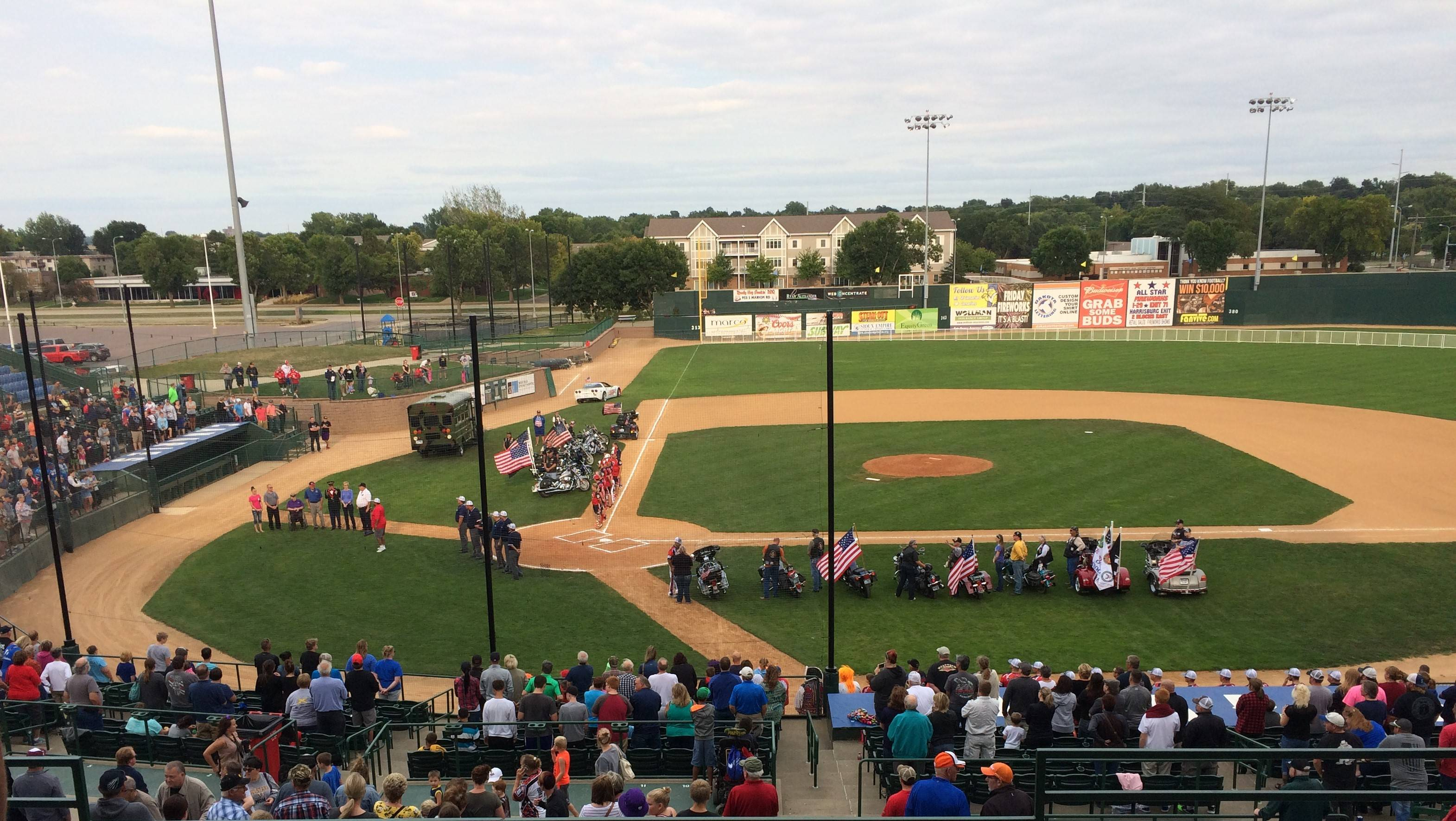 photo of baseball field with veterans