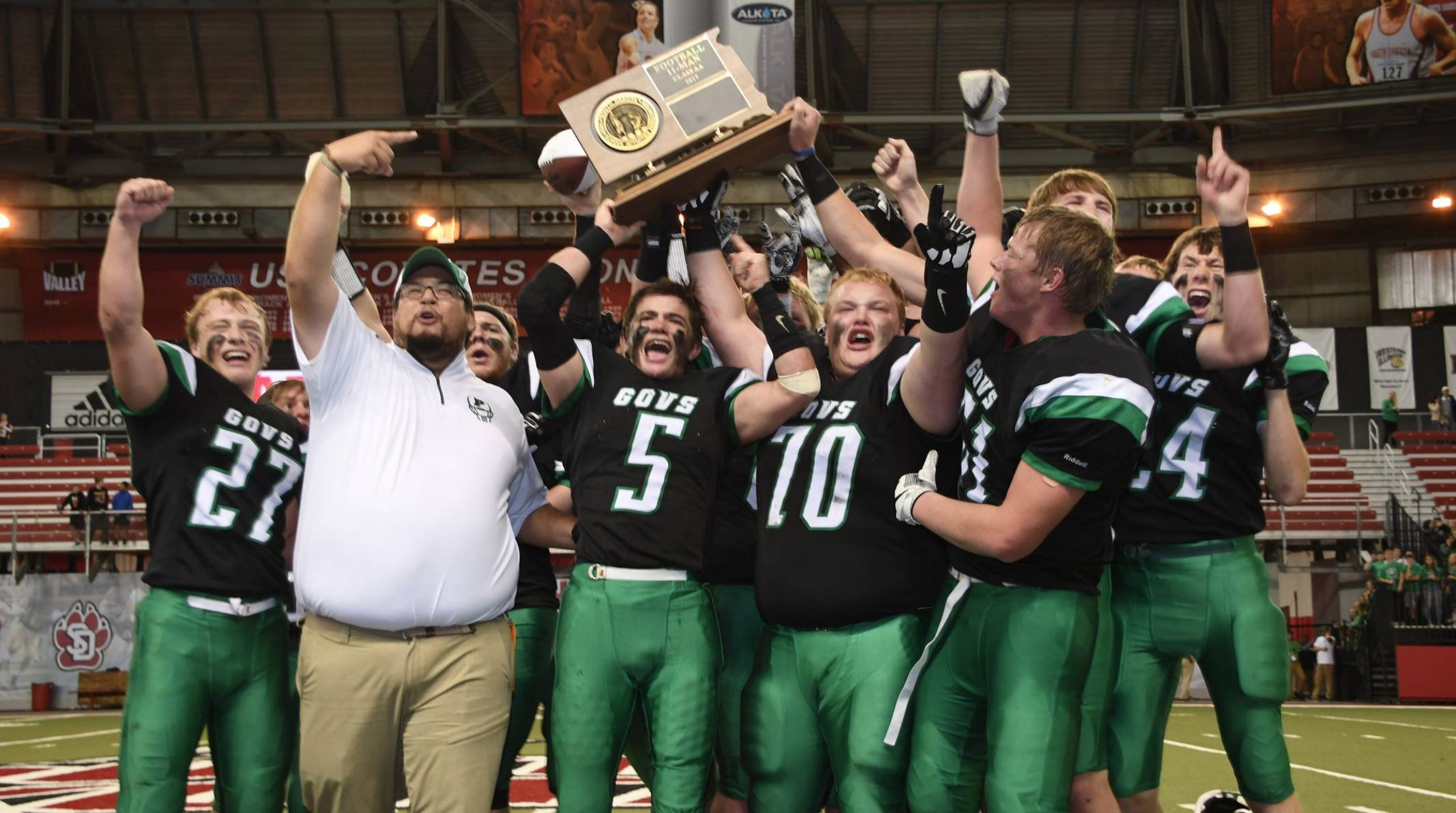 Pierre Govs football team holding state title