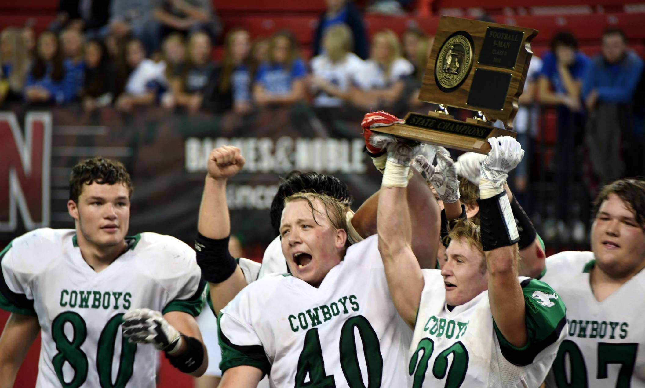 Colome Cowboys football team holding state title