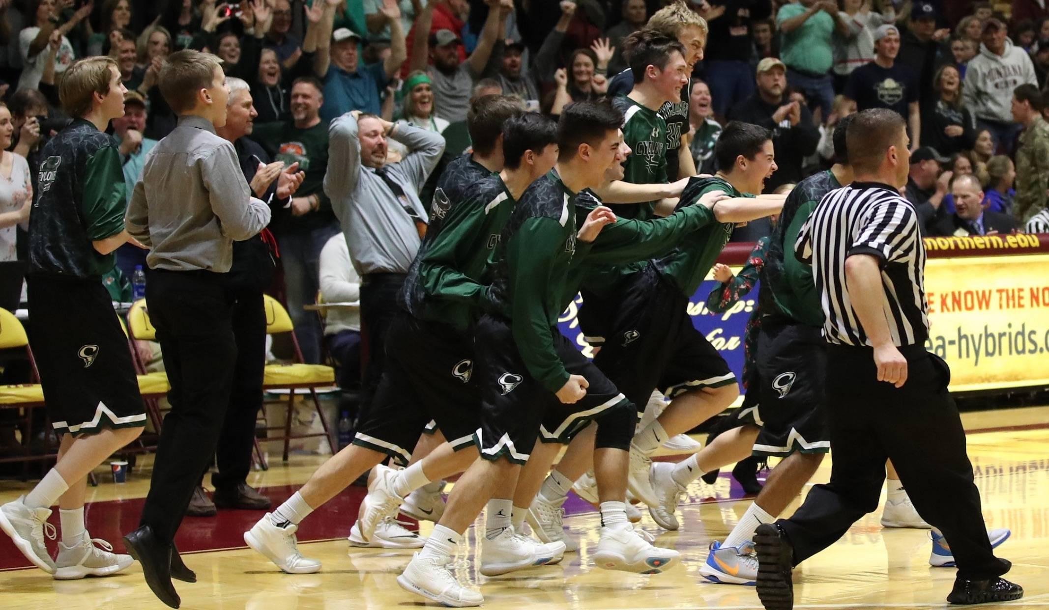 High school boys basketball team celebrating