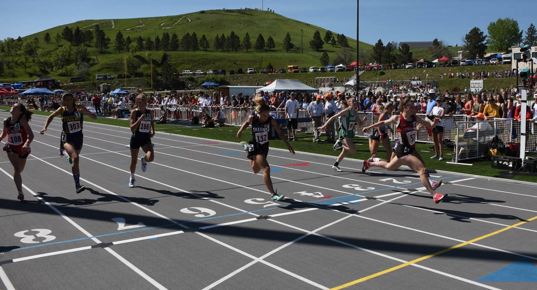 Track runners crossing the finish line