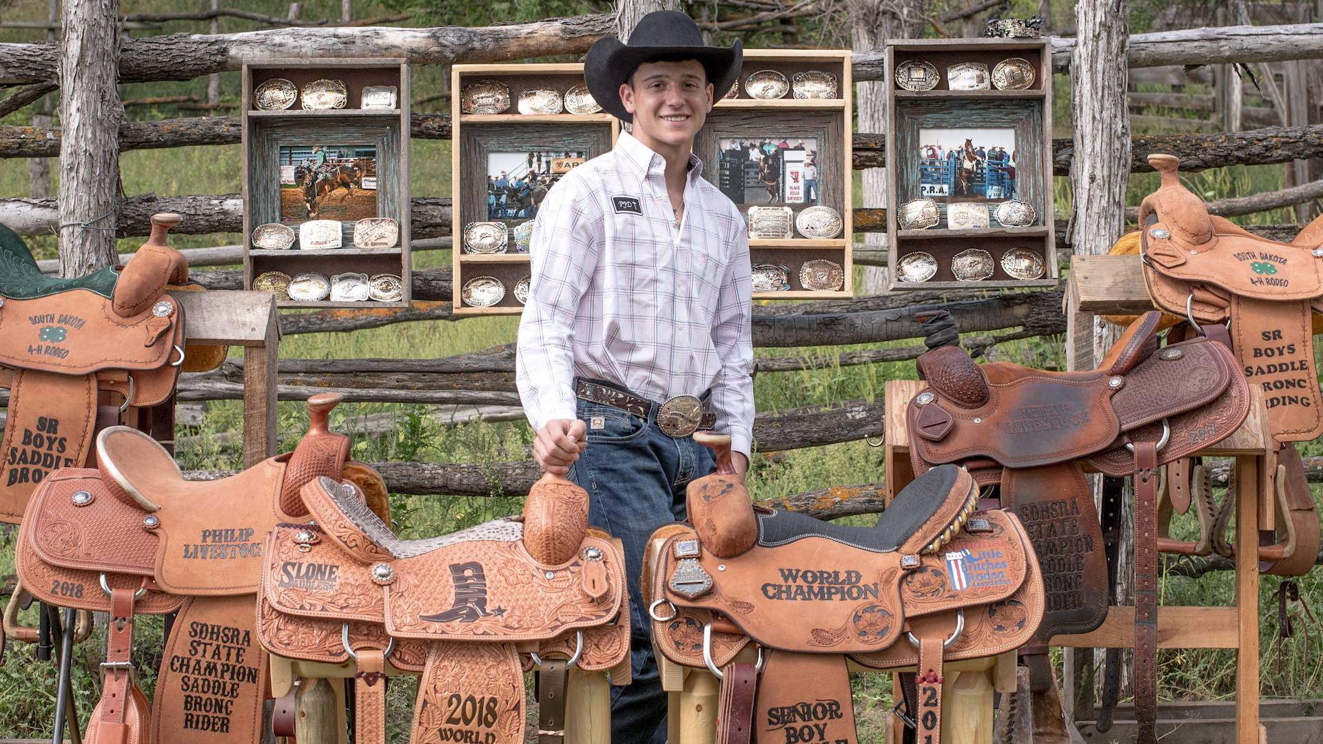 Cash Wilson with his saddles and buckles