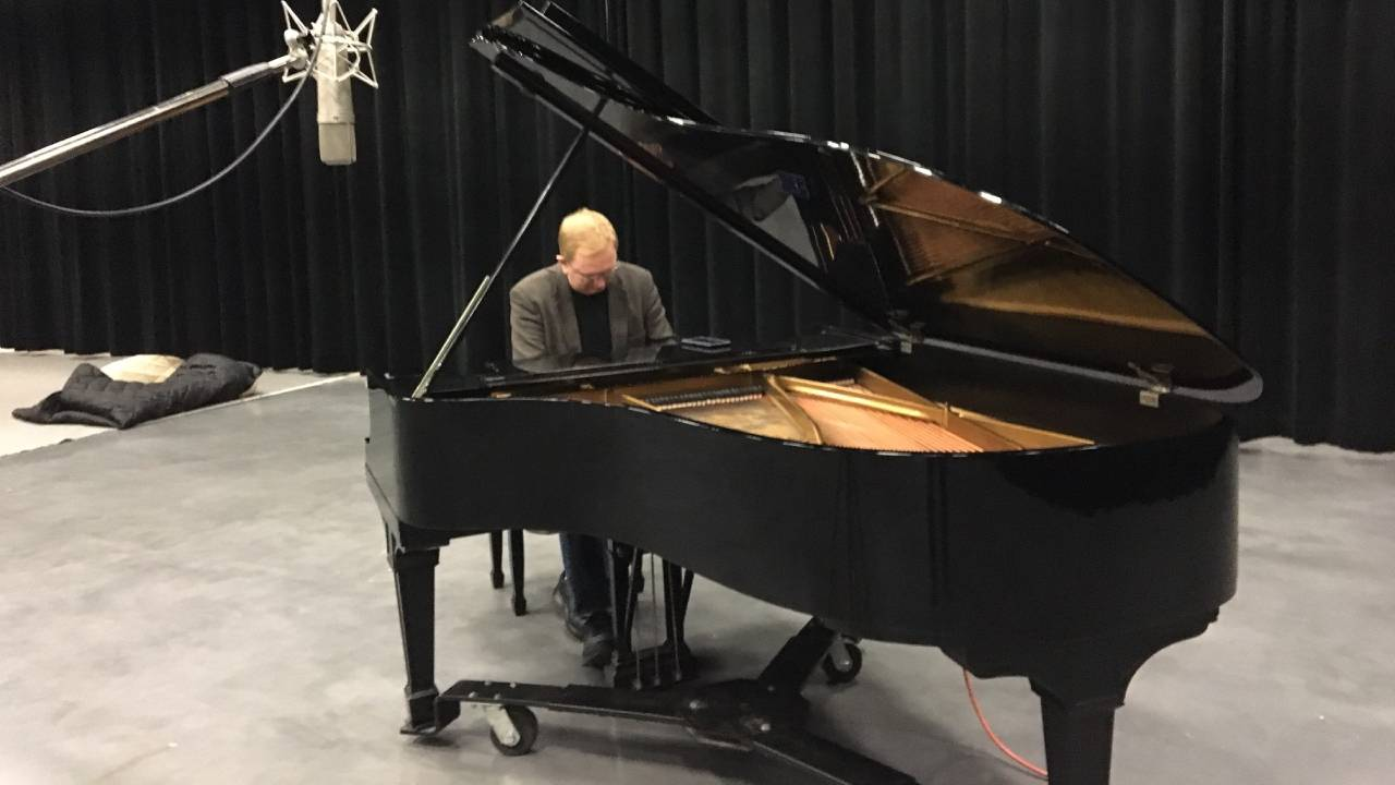 Kevin Cole playing the piano in WMHT's studios