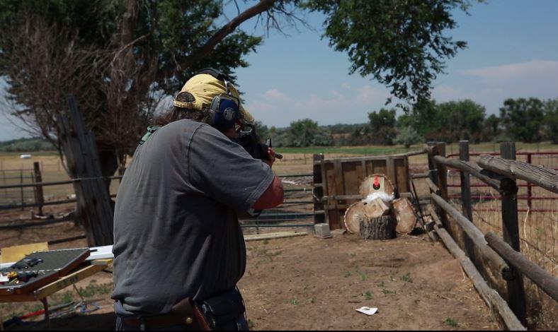 Image - Dr. John Moore demonstrates his AR-15.JPG