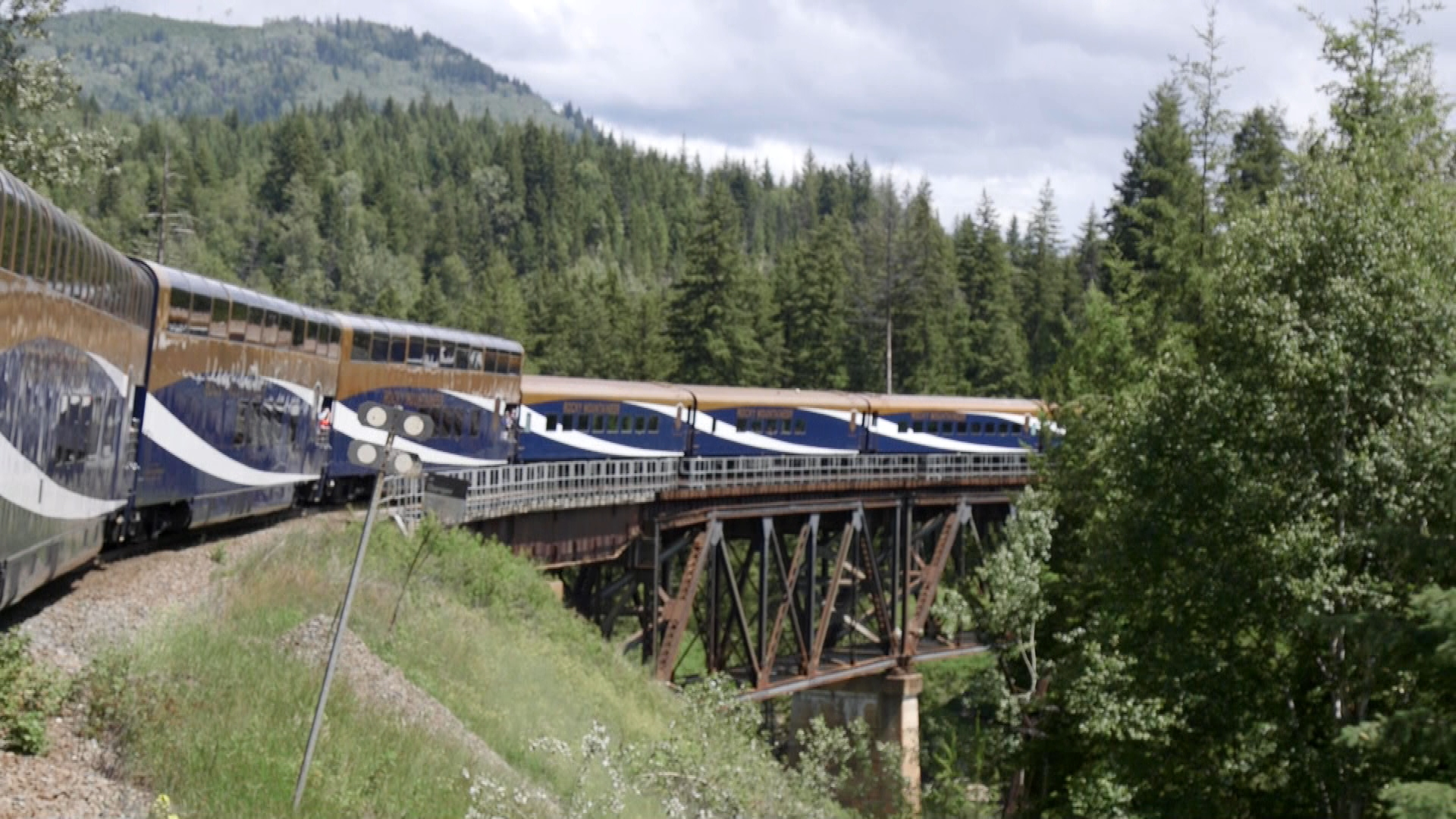 Rocky Mountaineer crosses a bridge