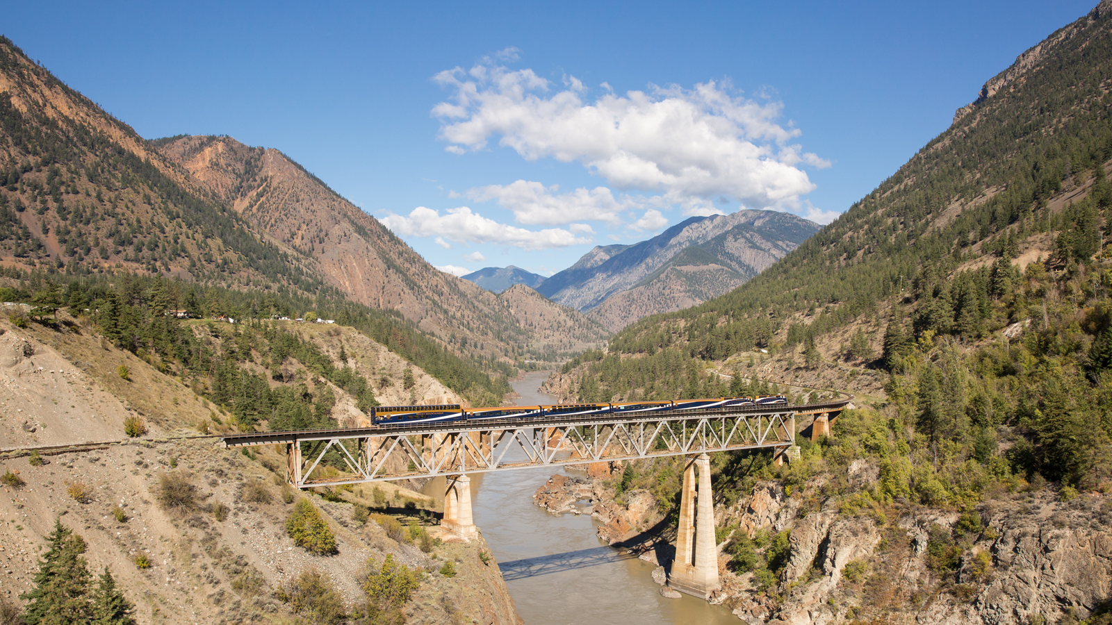 Rocky Mountaineer traveling across the Fraser River