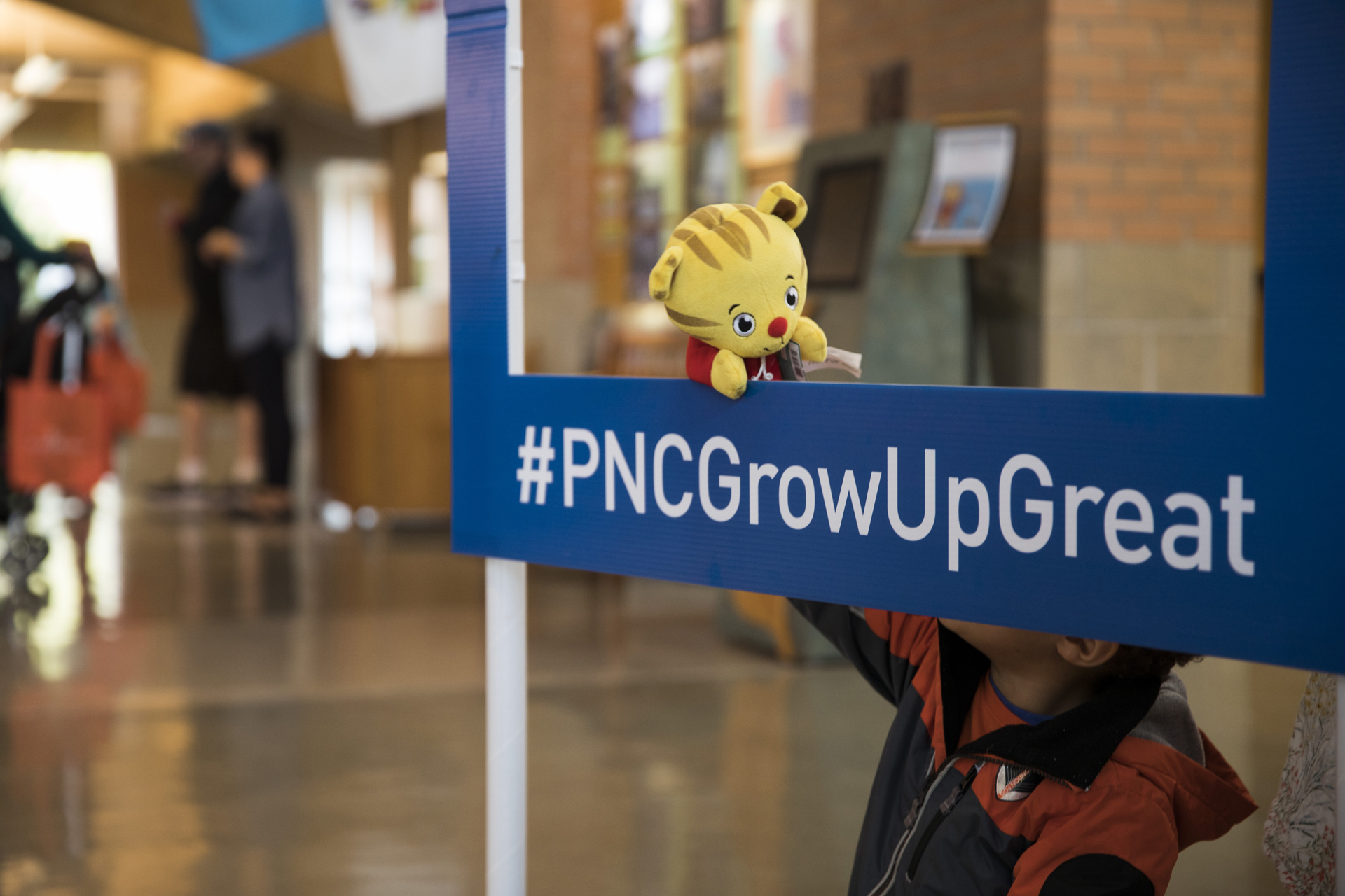 Daniel Tiger puppet at PNCGrowUpGreat sign