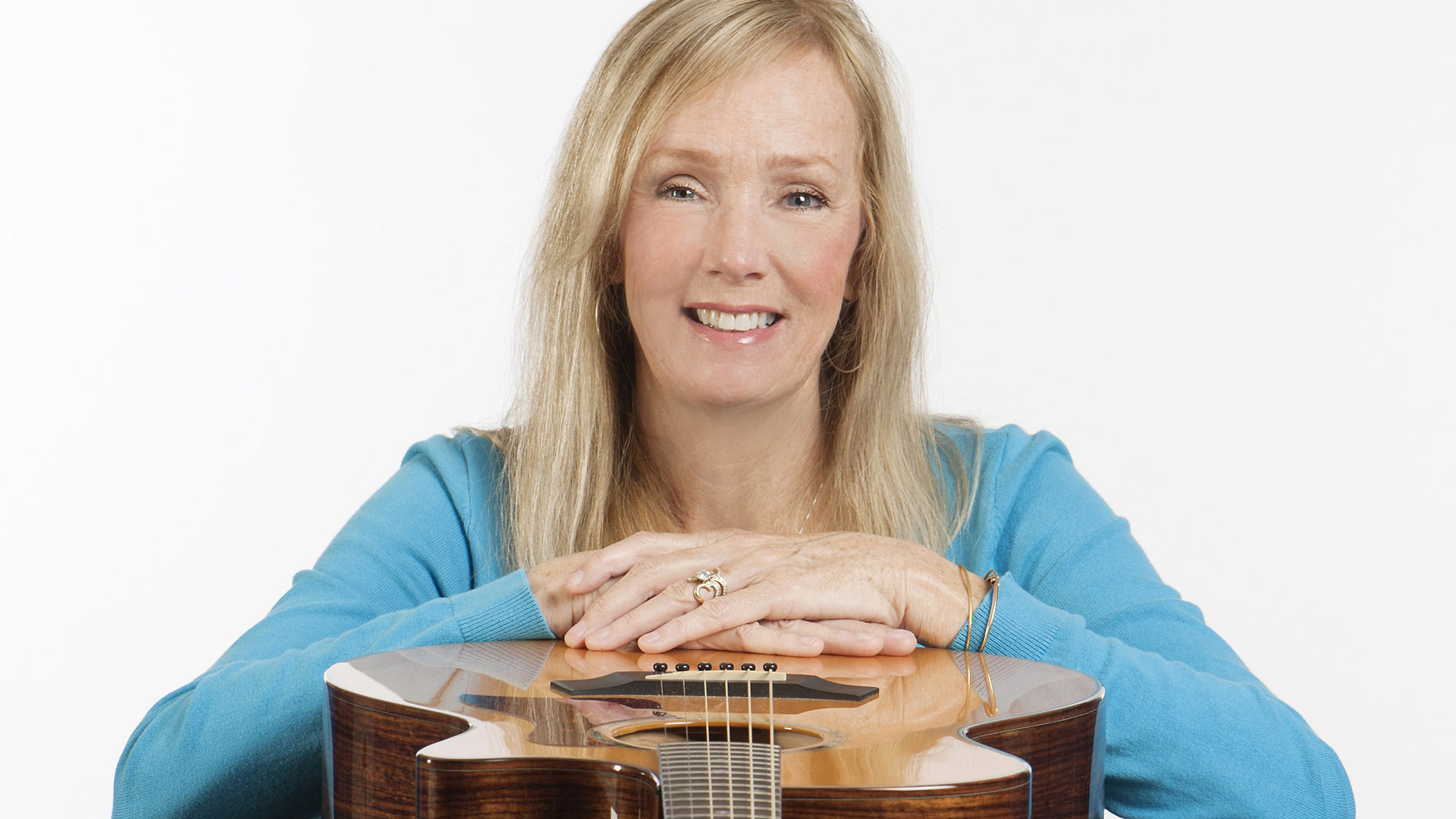Marlene Hutchinson with guitar