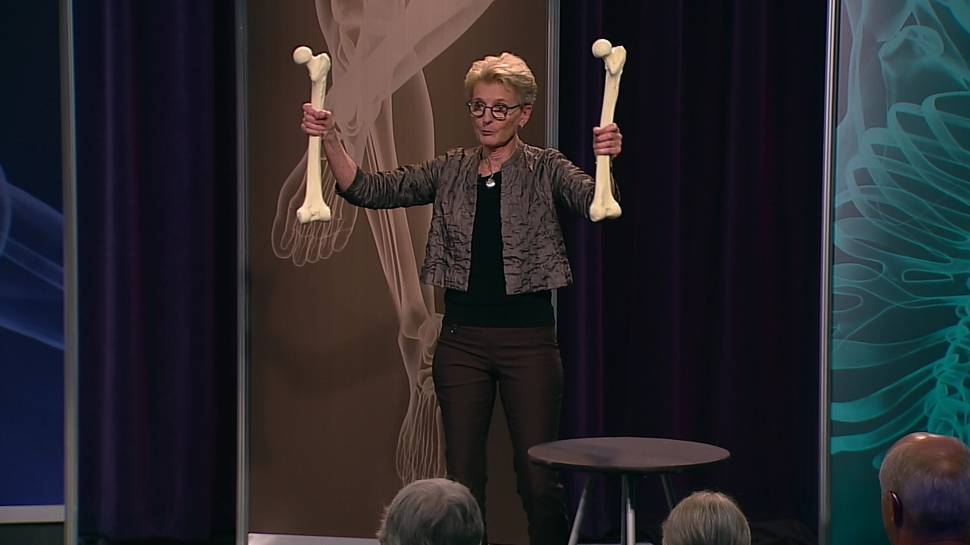 Lani Simpson holding two bones