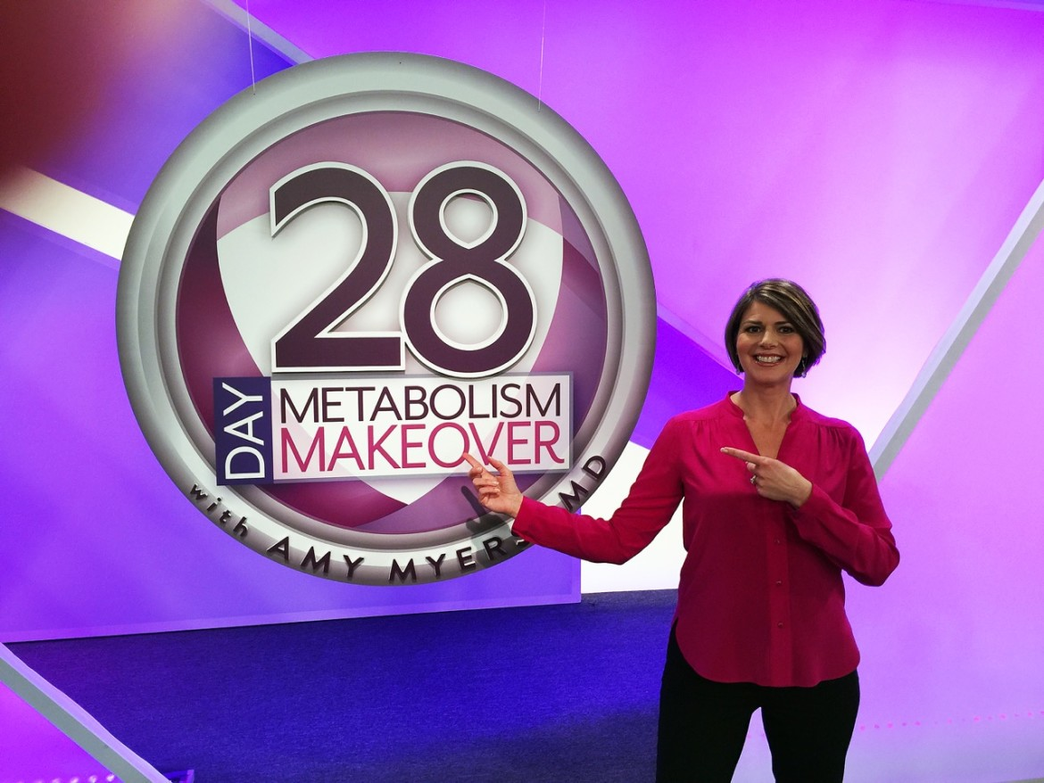 "Woman points to sign that reads ""28 day metabolism makeover"""