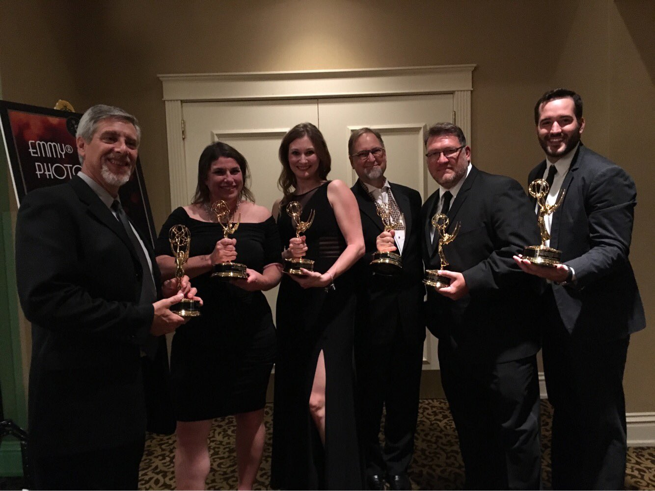 Part of the KCPT gang with their golden statuettes. We're proud of the work we're doing in and for the community.