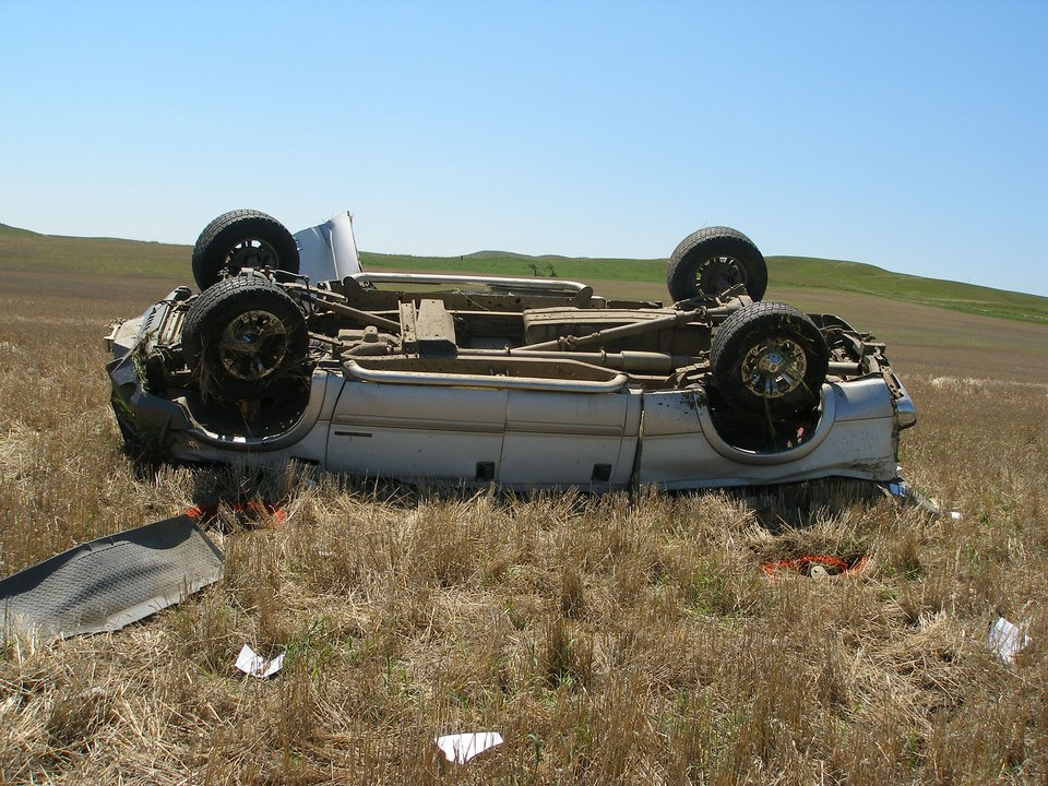 Distracted driving aftermath accident Sidney rollover