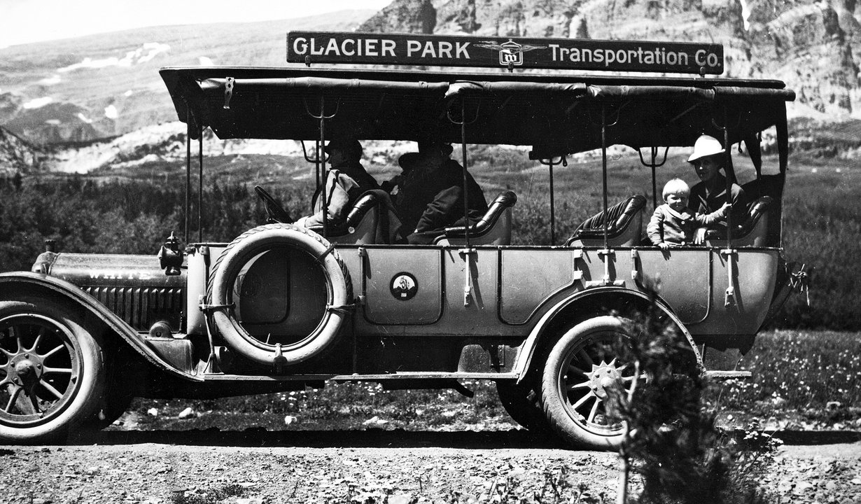 Early touring bus - 1914 Glacier Park Archives