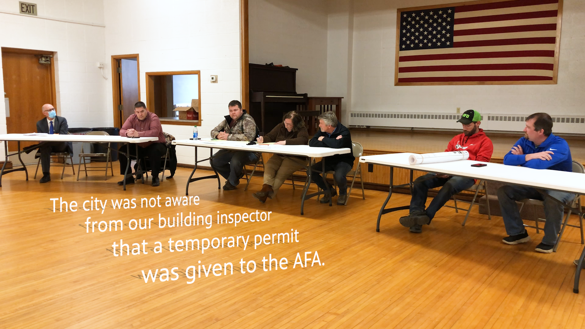 """A photo of the Murdock City Council during their April meeting with text that says, """"The city was not aware from our building inspector that a temporary permit was given to the AFA."""""""