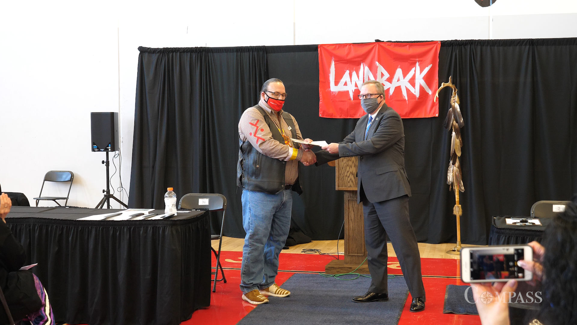 Lower Sioux Chairman Robert Larsen shakes hand with the Minnesota Historical Society's executive director.