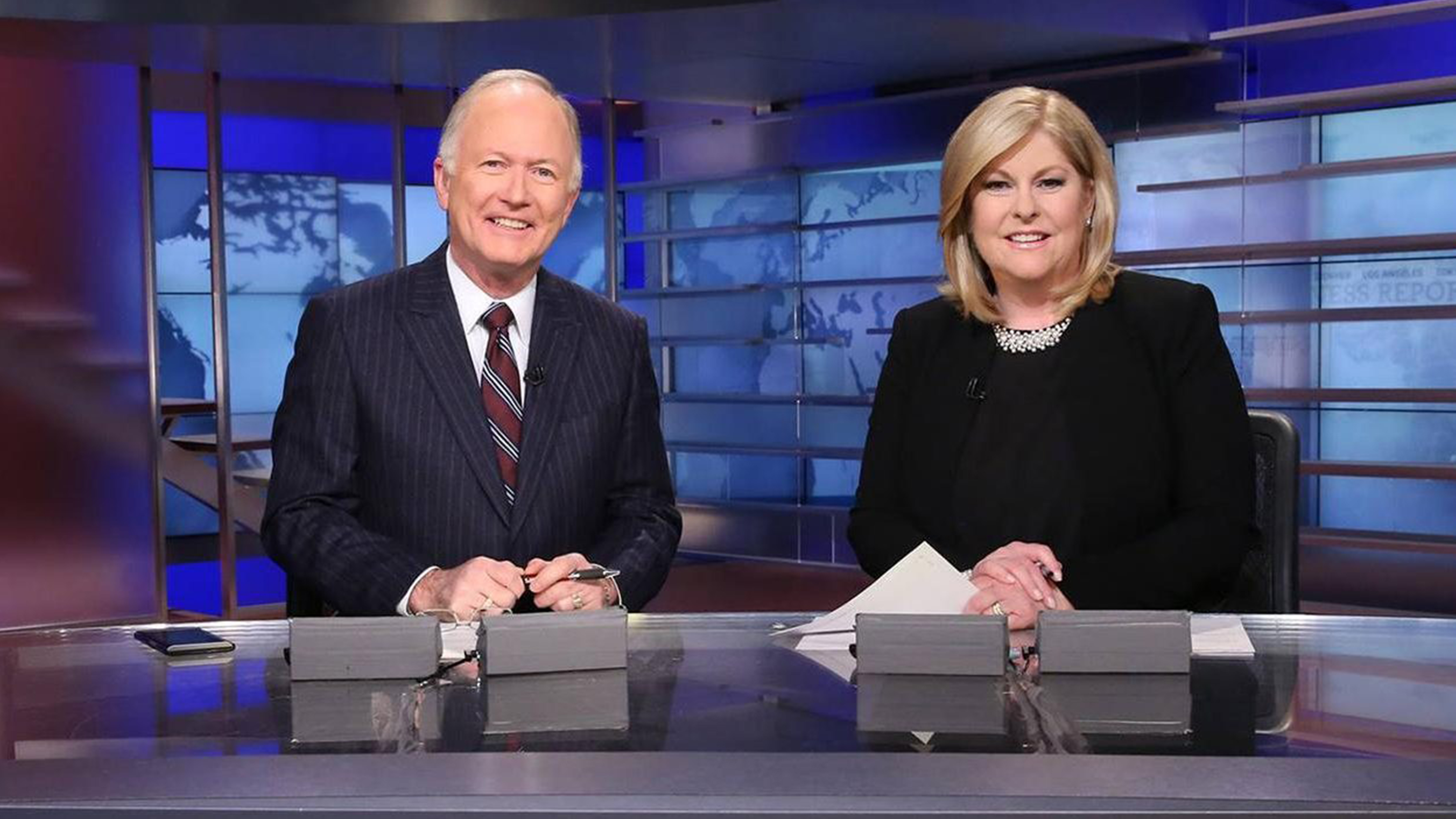 Download a photo of Nightly Business Report anchors Bill Griffeth and Sue Herera.