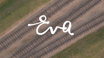 3 sets of railroad tracks viewed from above witht he word Eva in the foreground
