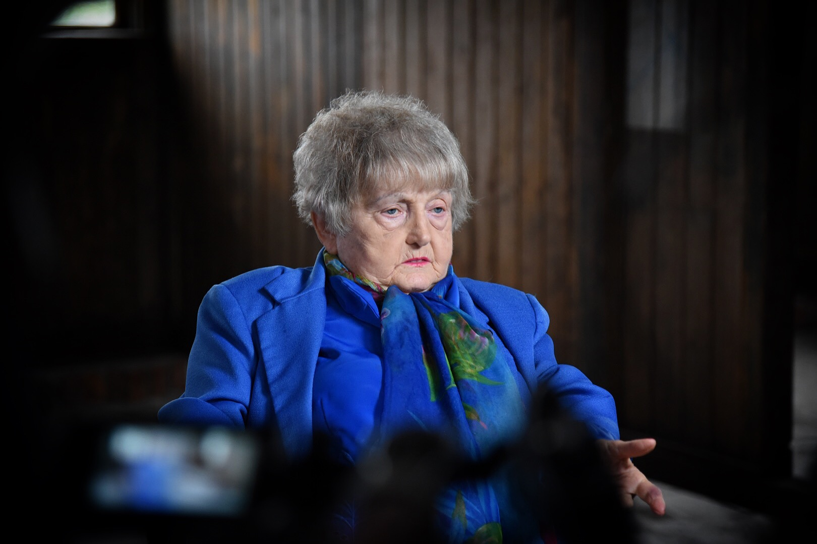 Eva Kor speaks at a barracks at Birkenau, Auschwitz.