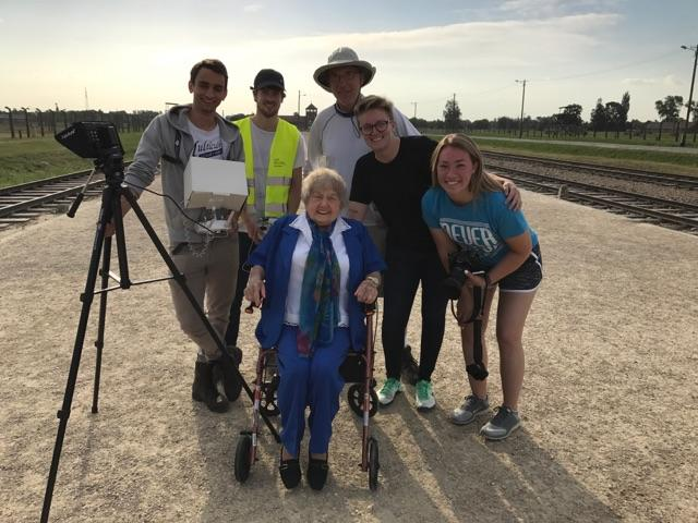 The documentary film crew with Eva Kor near the railroad tracks that brought Jewish men, women and children to Auschwitz.