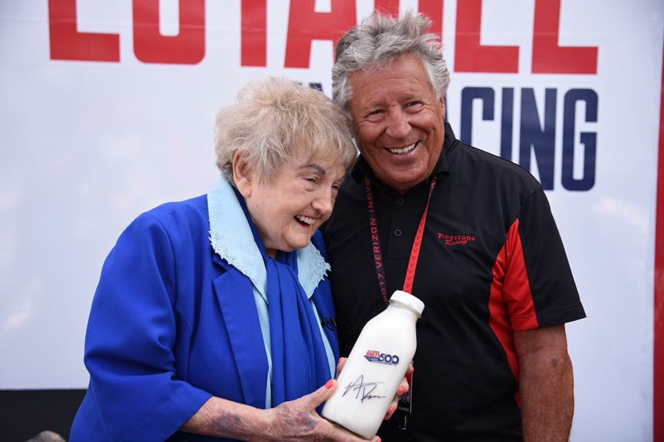 Eva Kor with racing icon Mario Andretti.