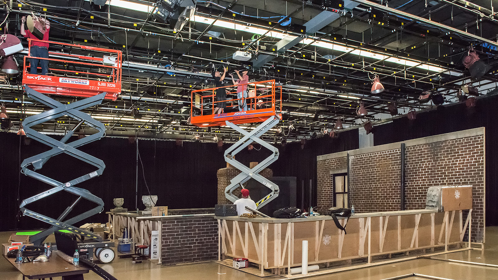 "roduction crew on the WNED | WBFO stage (Studio One) erecting the set for the film ""Marshall."""