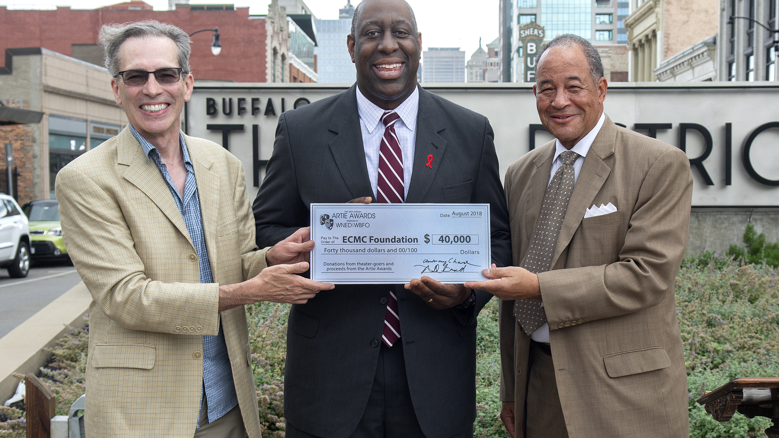 A check of $40,000 from the Arties and WNED | WBFO presented to ECMC Immunodeficiency (HIV/AIDS) Services Aug. 6, 2018 in Plaza of the Stars.