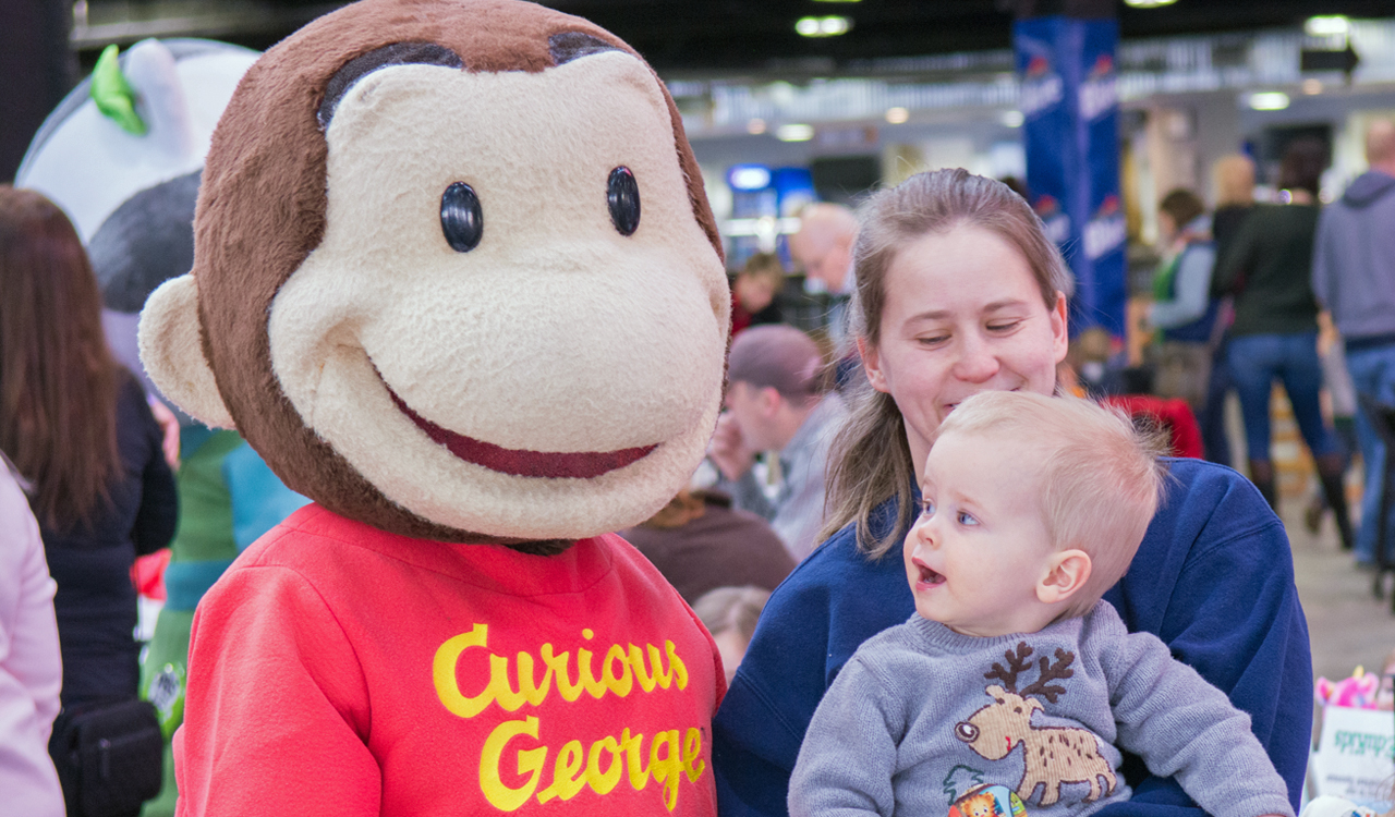 Curious George greets a young fan