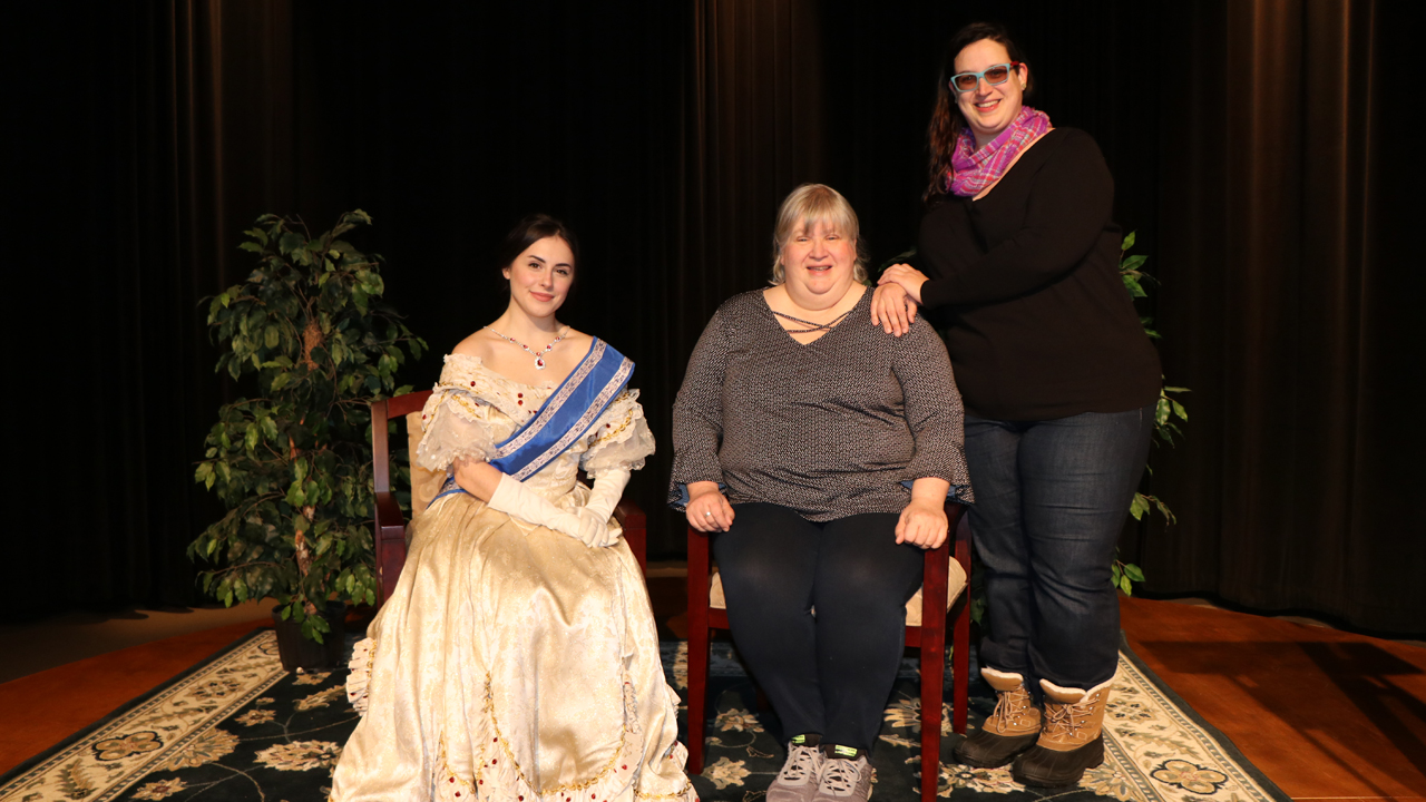 A local actress portrays Queen Victoria posing with fans at the WNED-TV Sneak Peek screening event