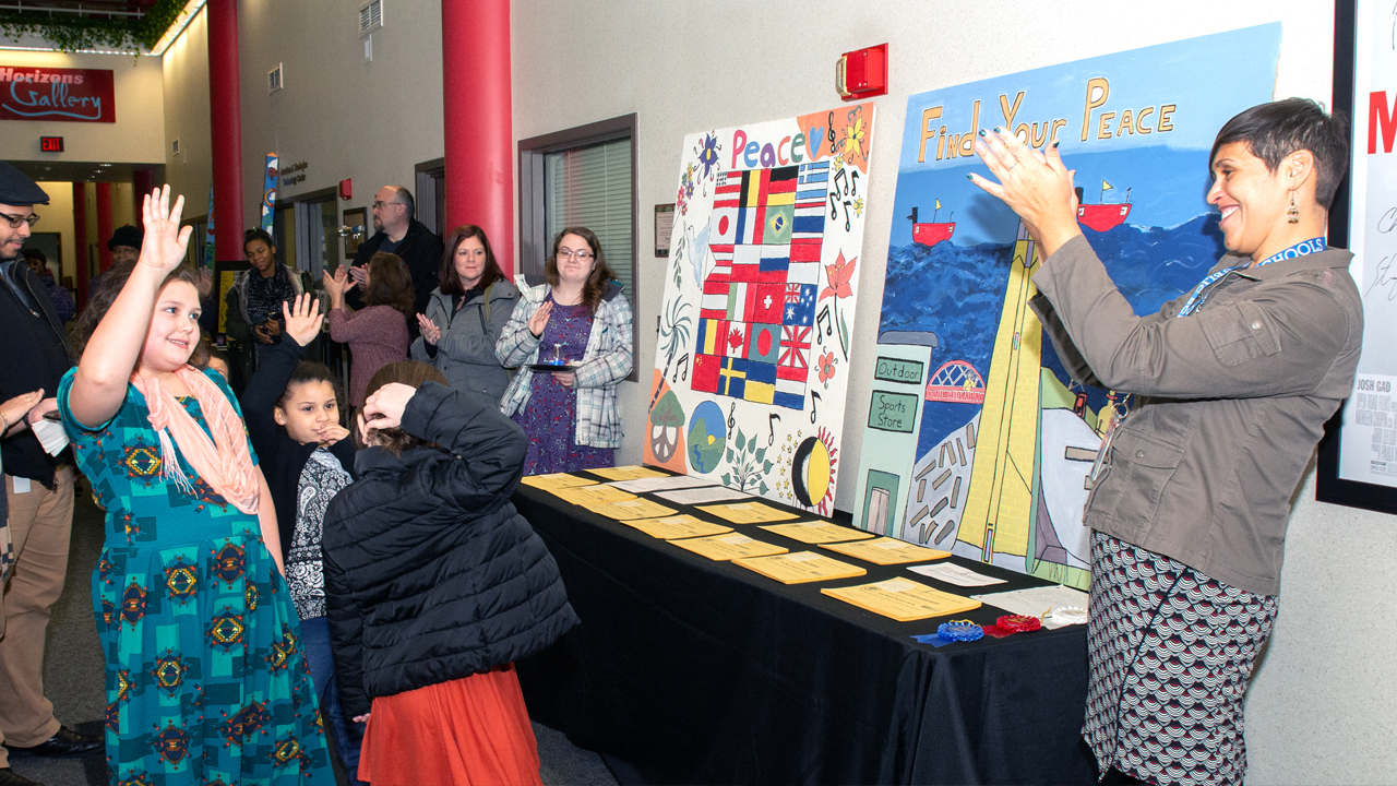 Young artists, parents, teachers and art lovers gathered for The Peace Project's opening reception.