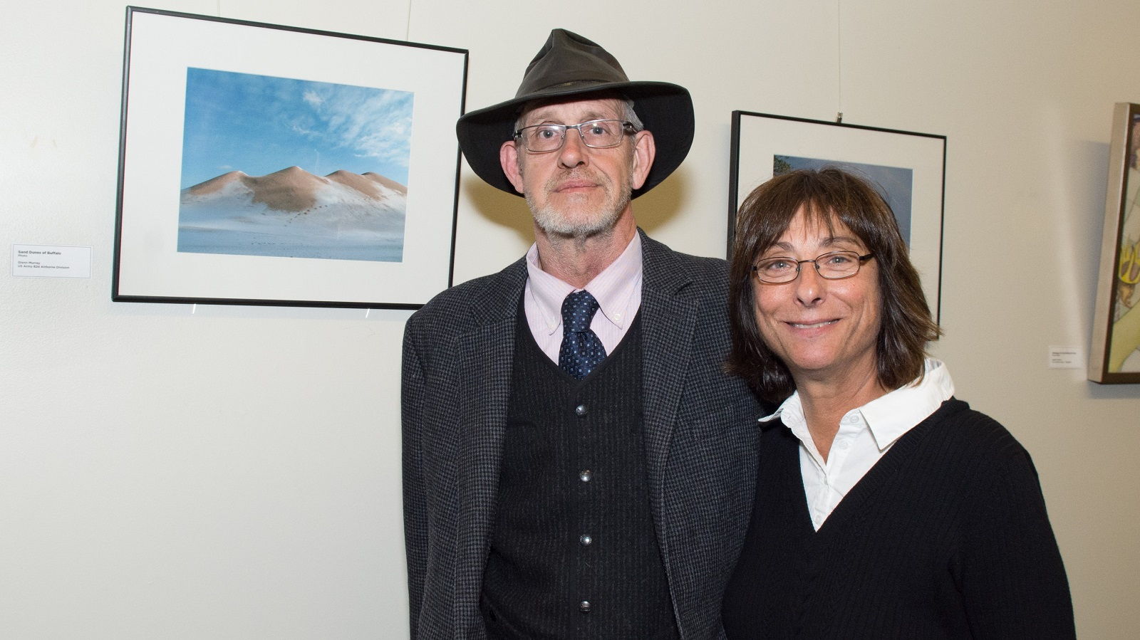 """Sand Dunes of Buffalo"" by Artist and Veteran Glenn Murray posing with curator Jackie Albarella"