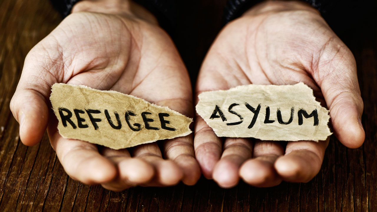 What is the difference between a refugee and an asylee?