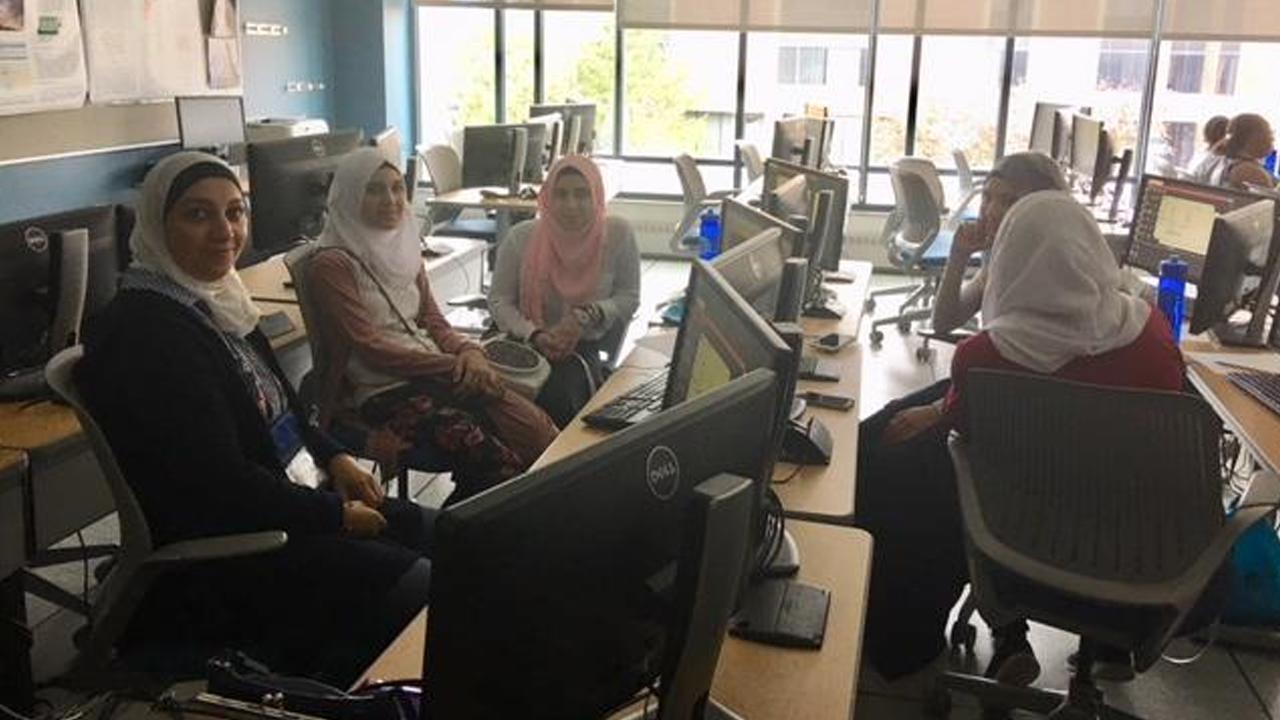 Immigrant & refugee teenage girls learn computer coding