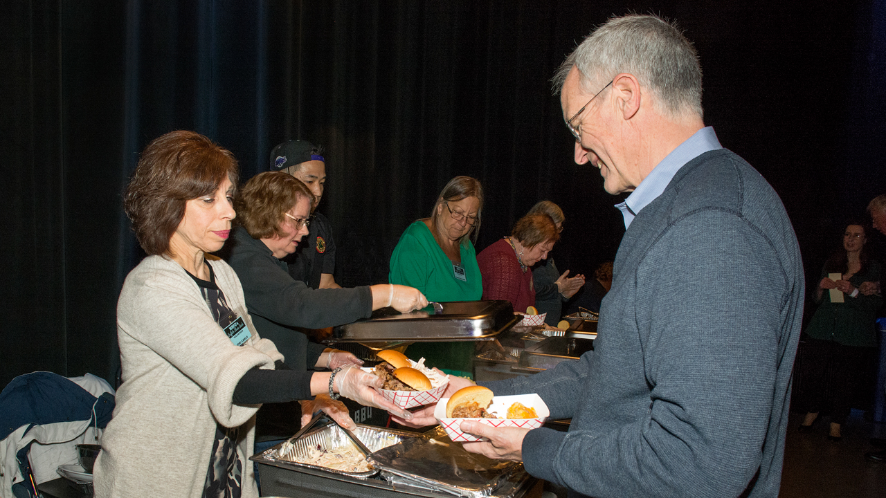 Volunteers serving food at WBFO's Buffalo Blues Bash