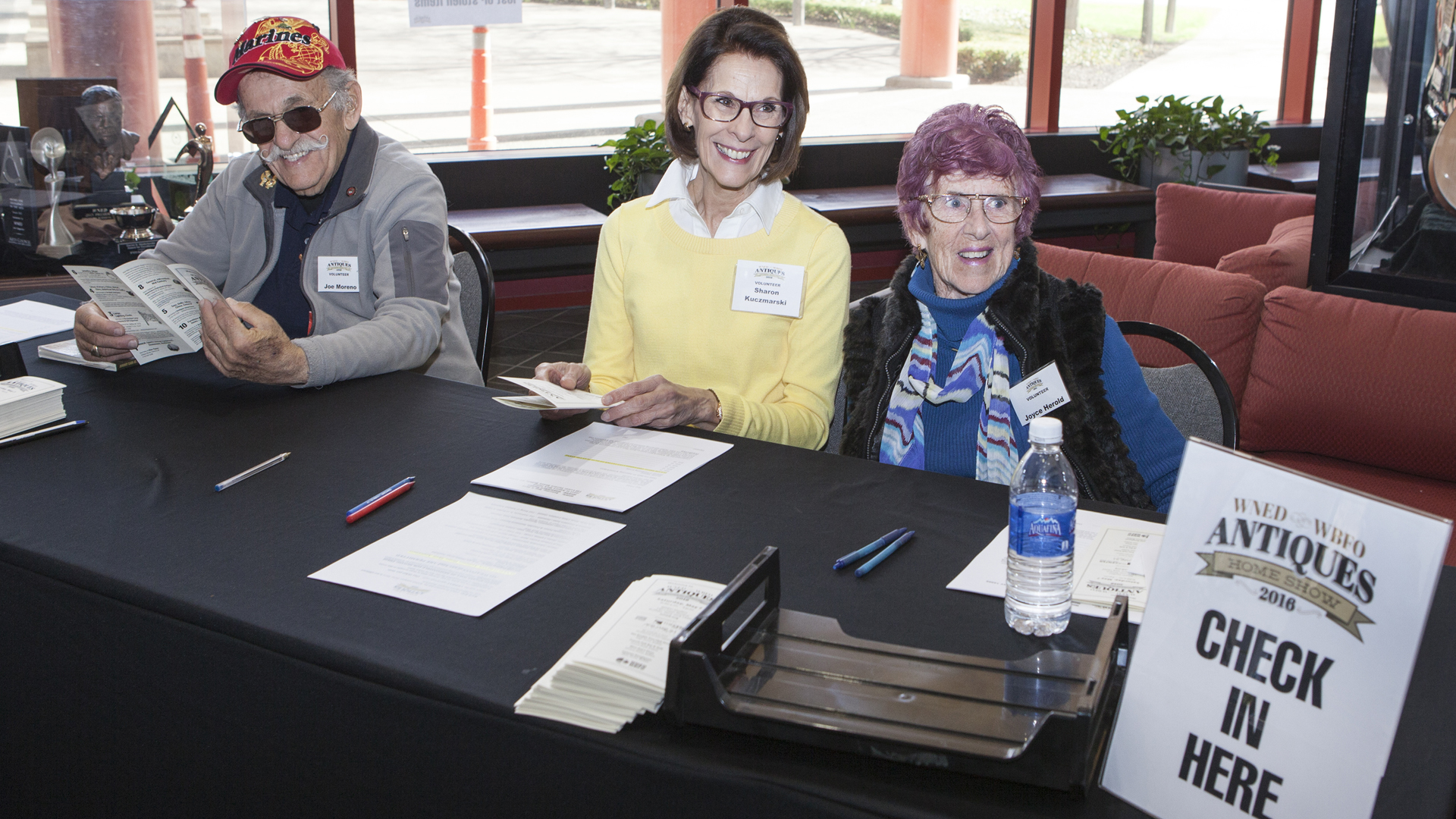Volunteers greet guests arriving for Antiques Home Show
