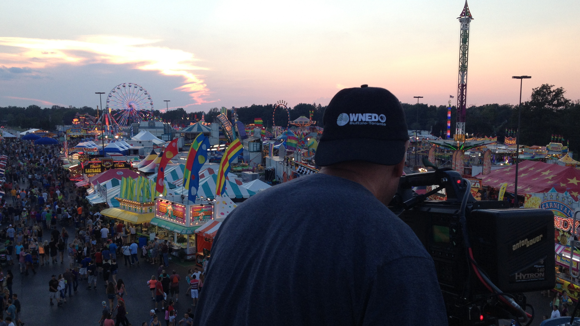 Photographer Jim Zinkowski captures images of the midway at sunset for The Great Erie County Fair