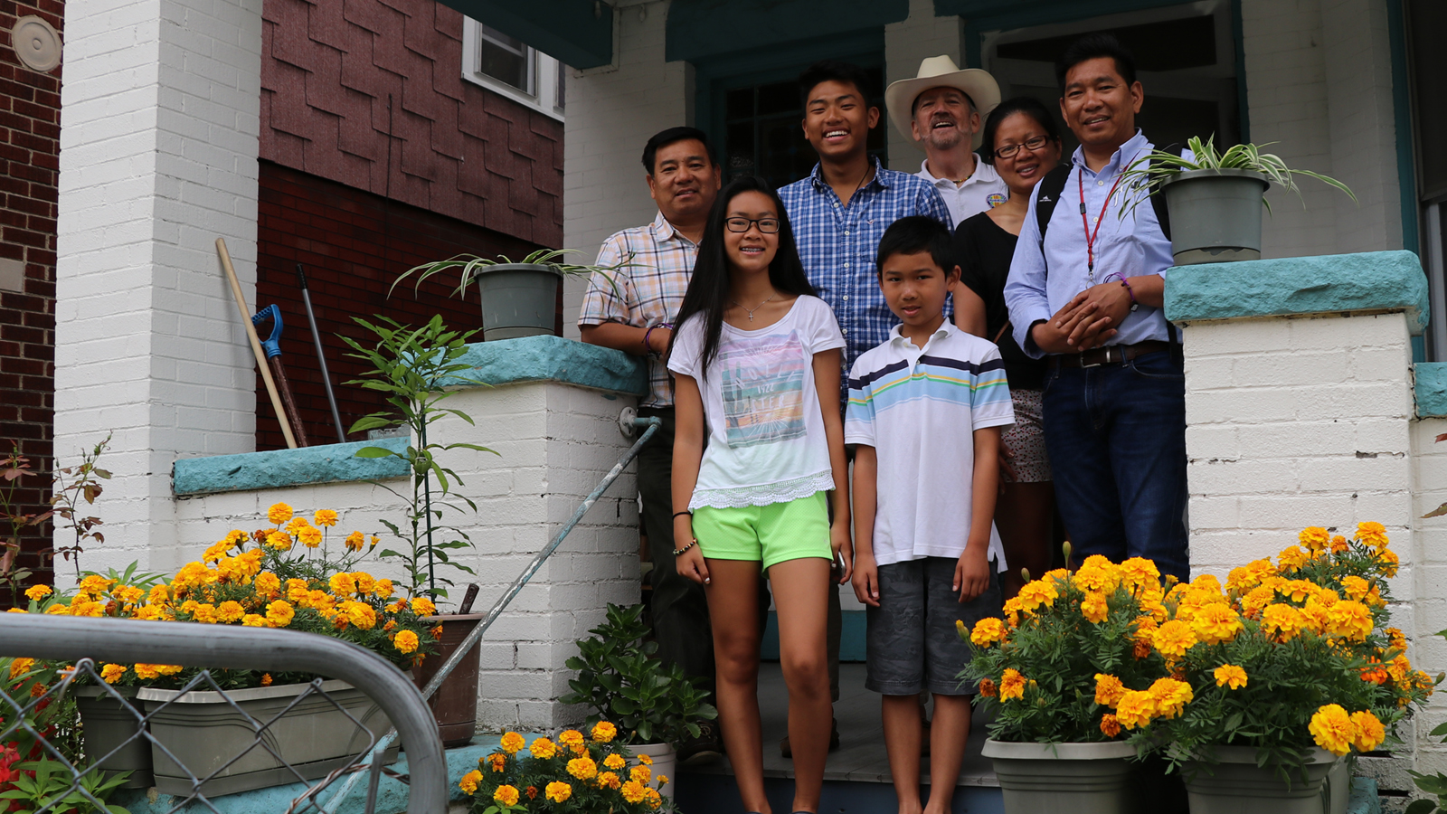 Brothers Minh and Tom Trân, their family, and Vietnam veteran Norm Murray. The Trân family escaped communist Vietnam in the late 1970's after the Vietnam war.