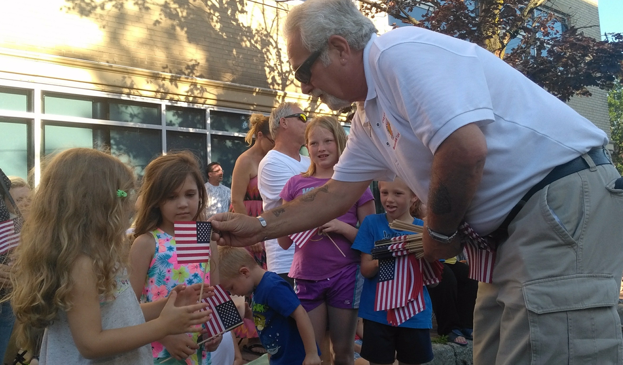 The young parade goers were especially excited to receive an American flag from Chapter 77 Vietnam veterans who passed them out along the route at Canalfest in Tonawanda, New York.